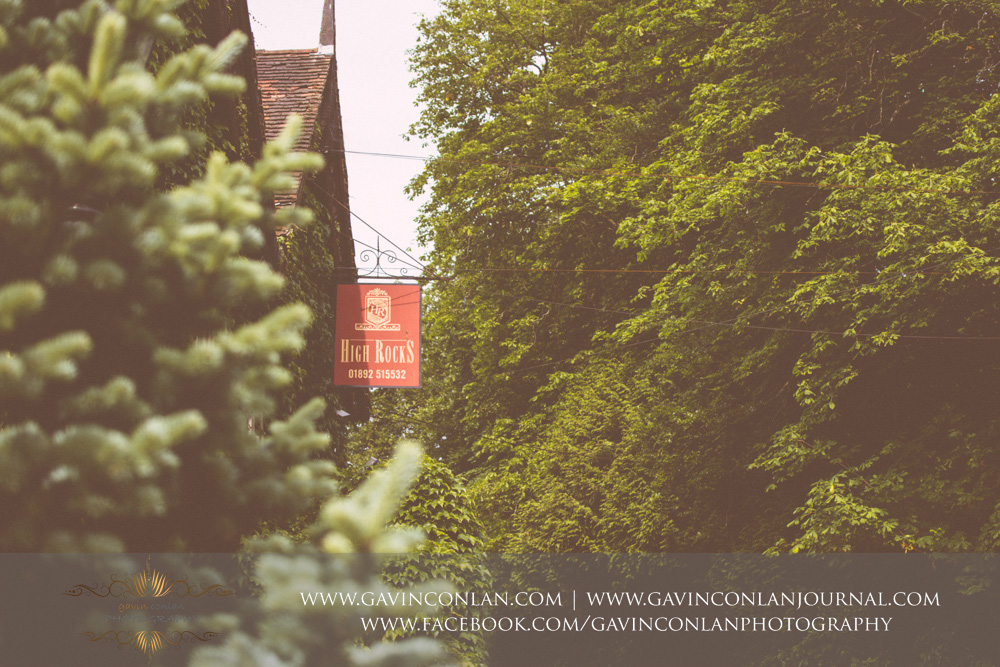 creative exterior photograph of the red High Rocks signage. Wedding photography at  High Rocks  by preferred supplier  gavin conlan photography Ltd