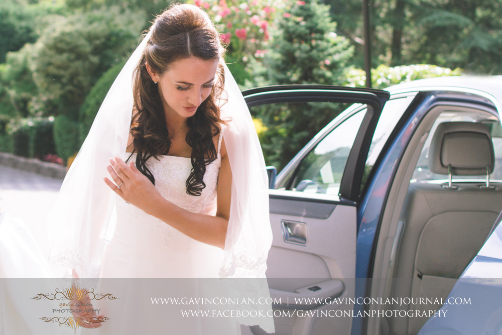 creative portrait of the bride stepping out of the wedding car before she heads into High Rocks. Wedding photography at  High Rocks  by preferred supplier  gavin conlan photography Ltd
