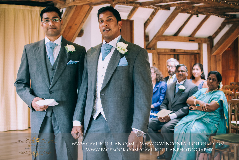 creative portrait of the groom and his best man waiting for the ceremony to begin in the Presidents Suite of High Rocks. Wedding photography at  High Rocks  by preferred supplier  gavin conlan photography Ltd