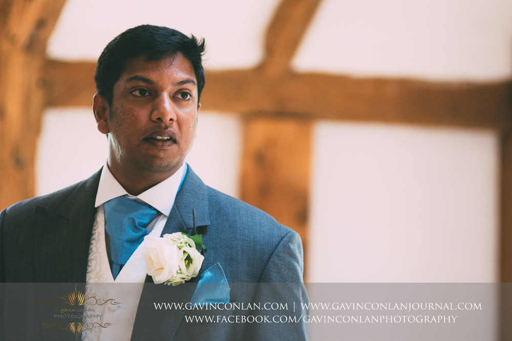 creative close up portrait of the groom during the wedding ceremony in the Presidents Suite of High Rocks. Wedding photography at  High Rocks  by preferred supplier  gavin conlan photography Ltd