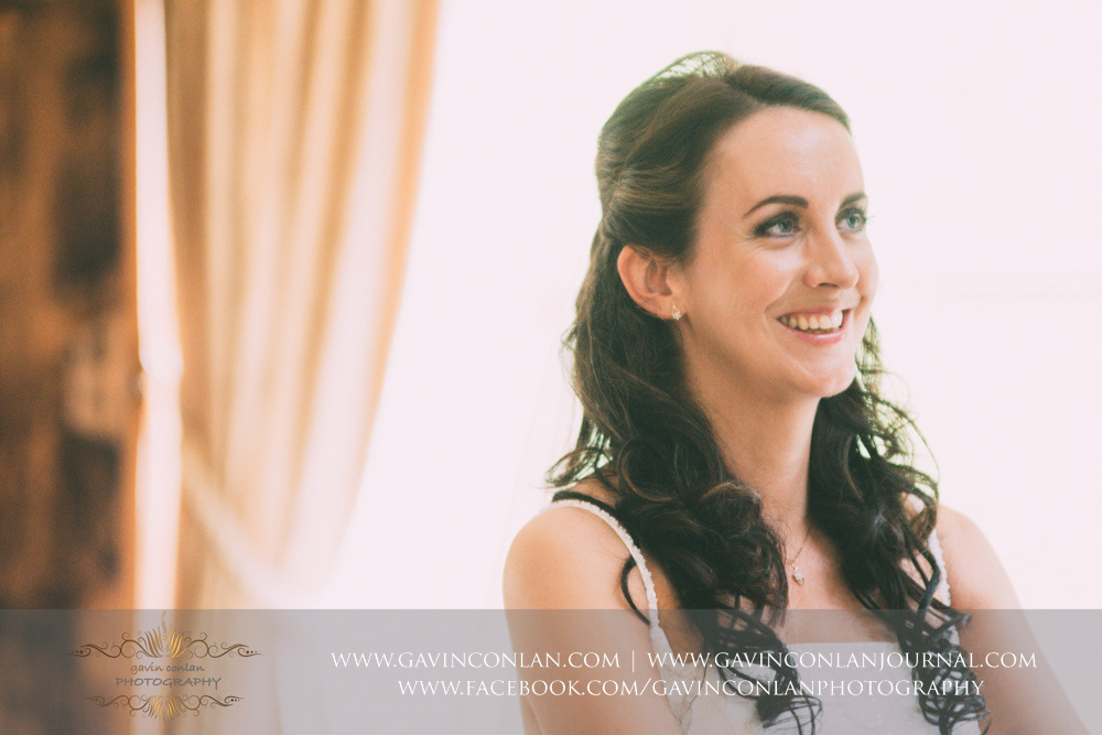 creative close up portrait of the bride during the wedding ceremony in the Presidents Suite of High Rocks. Wedding photography at  High Rocks  by preferred supplier  gavin conlan photography Ltd