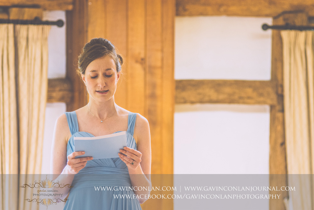creative ceremony portrait of the bridesmaid giving her reading in the Presidents Suite of High Rocks.Wedding photography at  High Rocks  by preferred supplier  gavin conlan photography Ltd