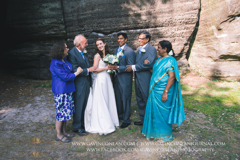 creative and fun portrait of the bride and groom and both sets of parents at The Rocks. Wedding photography at  High Rocks  by preferred supplier  gavin conlan photography Ltd