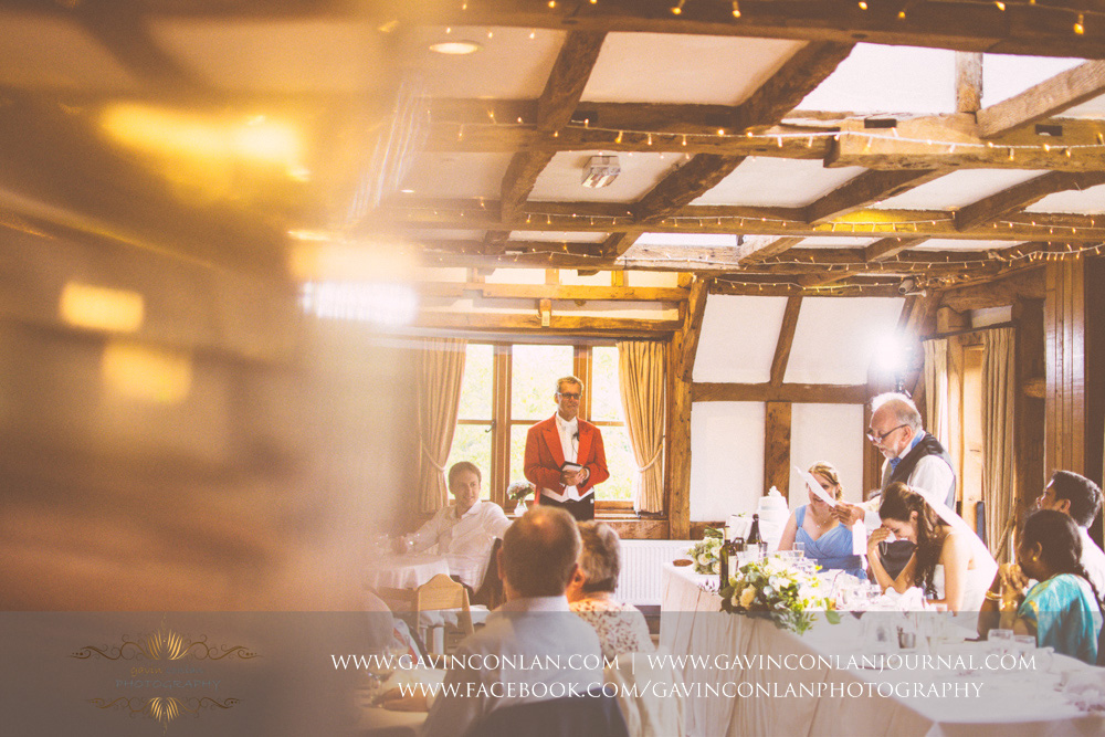 creative portrait of the father of the bride during his speech in the Presidents Suite of High Rocks. Wedding photography at  High Rocks  by preferred supplier  gavin conlan photography Ltd