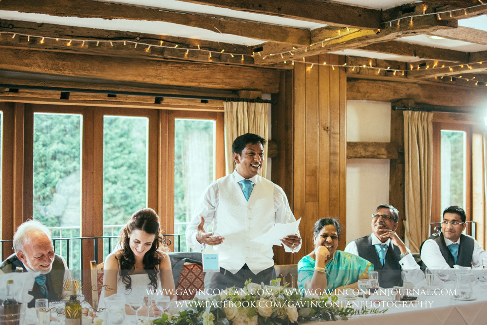 creative portrait of the groom during his speech in the Presidents Suite of High Rocks. Wedding photography at  High Rocks  by preferred supplier  gavin conlan photography Ltd