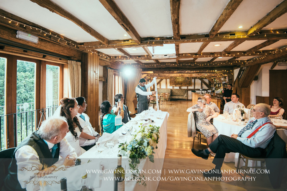 creative and fun portrait of the best man during his speech in the Presidents Suite of High Rocks. Wedding photography at  High Rocks  by preferred supplier  gavin conlan photography Ltd