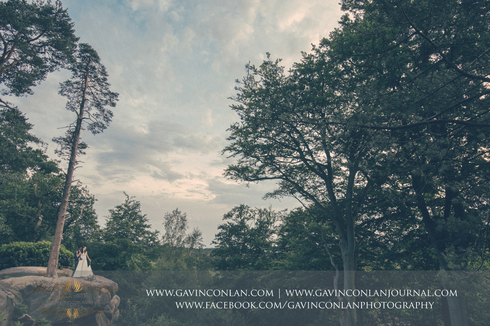 creative fine art portrait of the bride and groom at the top of The Rocks. Wedding photography at  High Rocks  by preferred supplier  gavin conlan photography Ltd