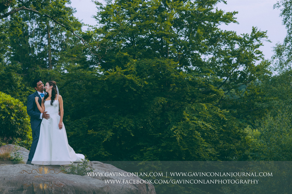 creative portrait of the bride and groom posing at the top of The Rocks. Wedding photography at  High Rocks  by preferred supplier  gavin conlan photography Ltd