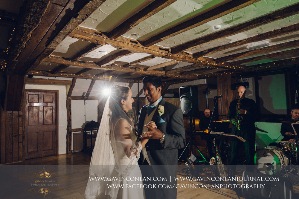 creative portrait of the bride and groom during their first dance in the Presidents Suite of High Rocks. Wedding photography at  High Rocks  by preferred supplier  gavin conlan photography Ltd