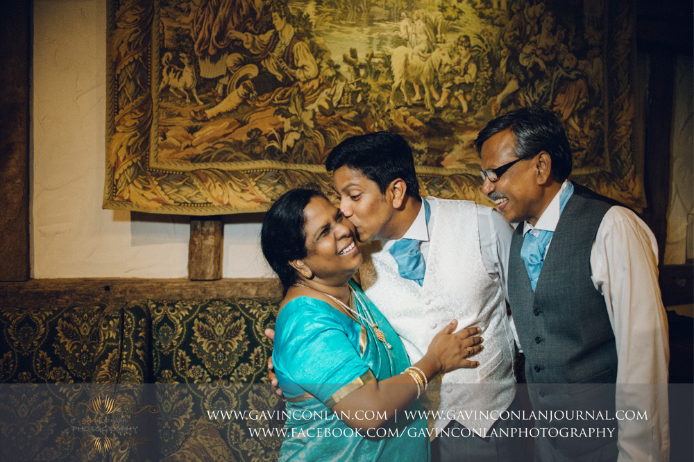 beautiful and emotive portrait of the groom with his mother and father in the Presidents Suite of High Rocks. Wedding photography at  High Rocks  by preferred supplier  gavin conlan photography Ltd
