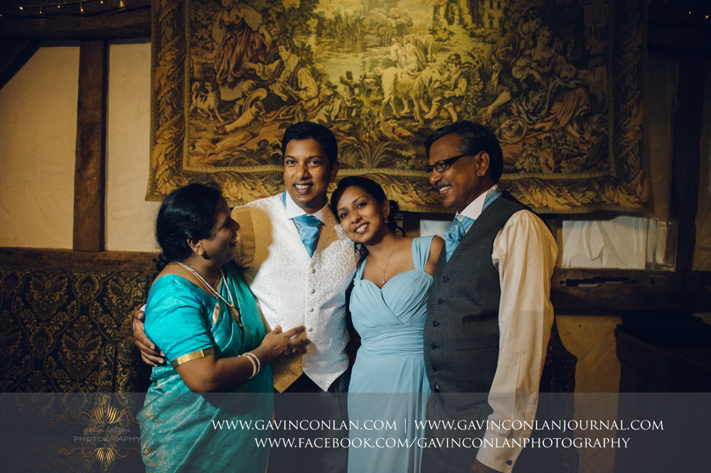 gorgeous portrait of the groom with his sister and parents in the Presidents Suite of High Rocks. Wedding photography at  High Rocks  by preferred supplier  gavin conlan photography Ltd