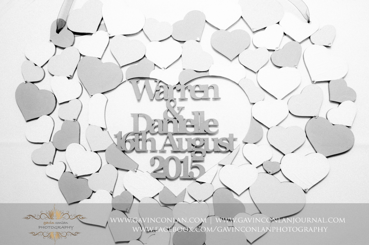 creative black and white heart shaped detail photograph with the names Warren and Danielle and their wedding date 16th August 2015 at Stock Brook Country Club. Wedding photography at  Stock Brook Country Club  by  gavin conlan photography Ltd