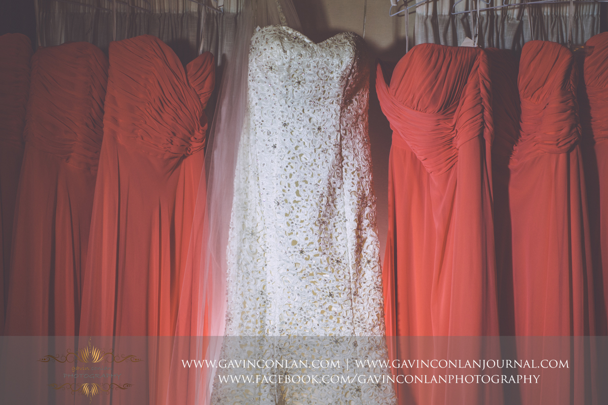 creative detail photograph showcasing the brides wedding dress and her bridesmaids at the Best Western Ivy Hill Hotel. Wedding photography at  Best Western Ivy Hill Hotel  by  gavin conlan photography Ltd