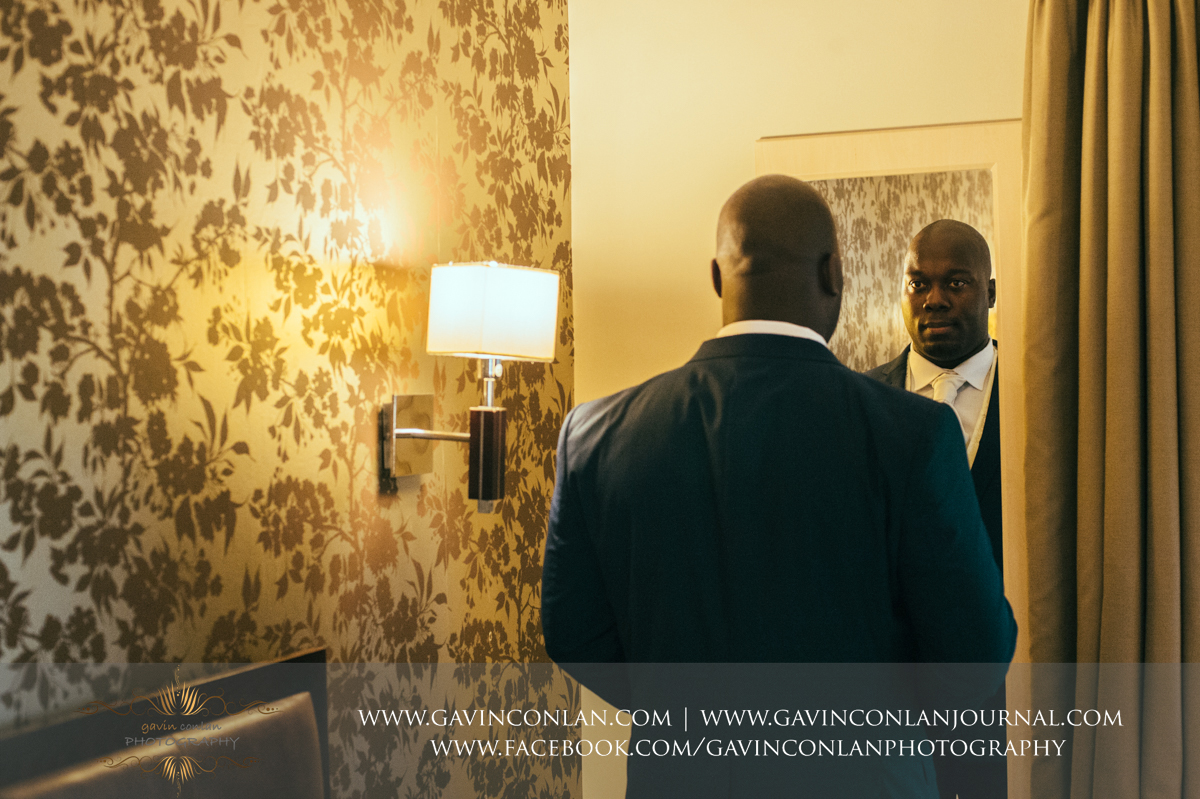 creative portrait of the groom looking at himself in the mirror at the Best Western Ivy Hill Hotel. Wedding photography at  Best Western Ivy Hill Hotel  by  gavin conlan photography Ltd