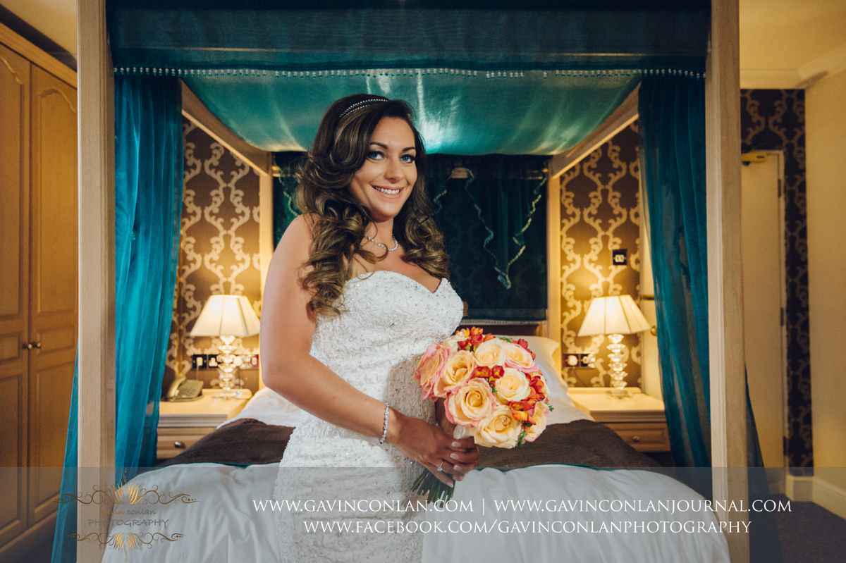 creative bridal portrait showing the bride holding her wedding bouquet at the Best Western Ivy Hill Hotel. Wedding photography at  Best Western Ivy Hill Hotel  by  gavin conlan photography Ltd