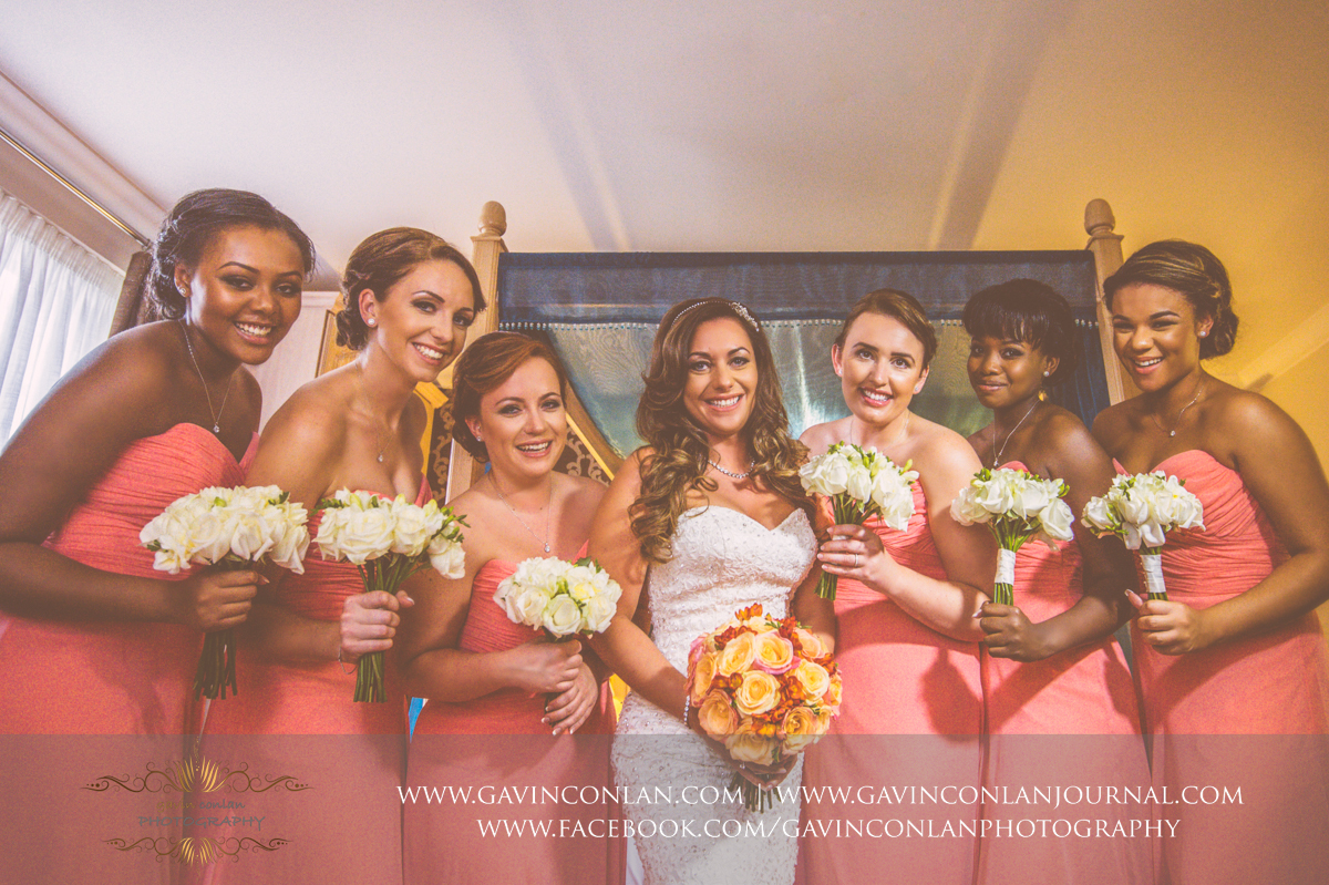 creative and fun portrait of the bride and her bridesmaids holding their wedding bouquets at the Best Western Ivy Hill Hotel. Wedding photography at  Best Western Ivy Hill Hotel  by  gavin conlan photography Ltd