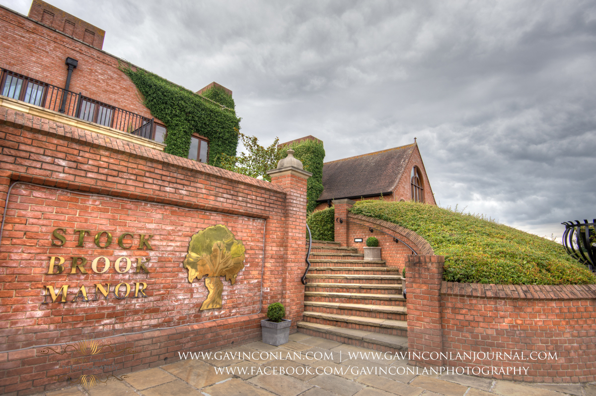creative exterior photograph of the main entrance showcasing the words Stock Brook Manor at Stock Brook Country Club. Wedding photography at  Stock Brook Country Club  by  gavin conlan photography Ltd