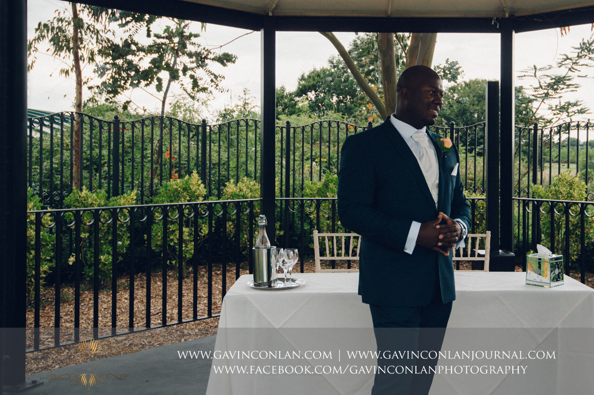 creative portrait of the groom on The Lawn at Stock Brook Country Club. Wedding photography at  Stock Brook Country Club  by  gavin conlan photography Ltd