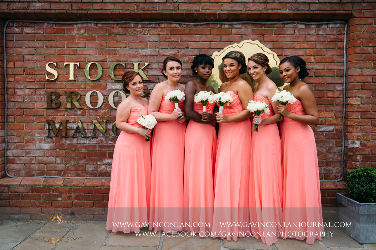 creative portrait of the bridesmaids at the main entrance of Stock Brook Country Club. Wedding photography at  Stock Brook Country Club  by  gavin conlan photography Ltd