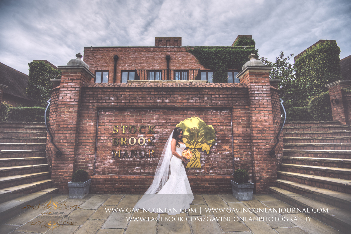 creative and beautiful bridal portrait in front of the main entrance of Stock Brook Country Club. Wedding photography at  Stock Brook Country Club  by  gavin conlan photography Ltd