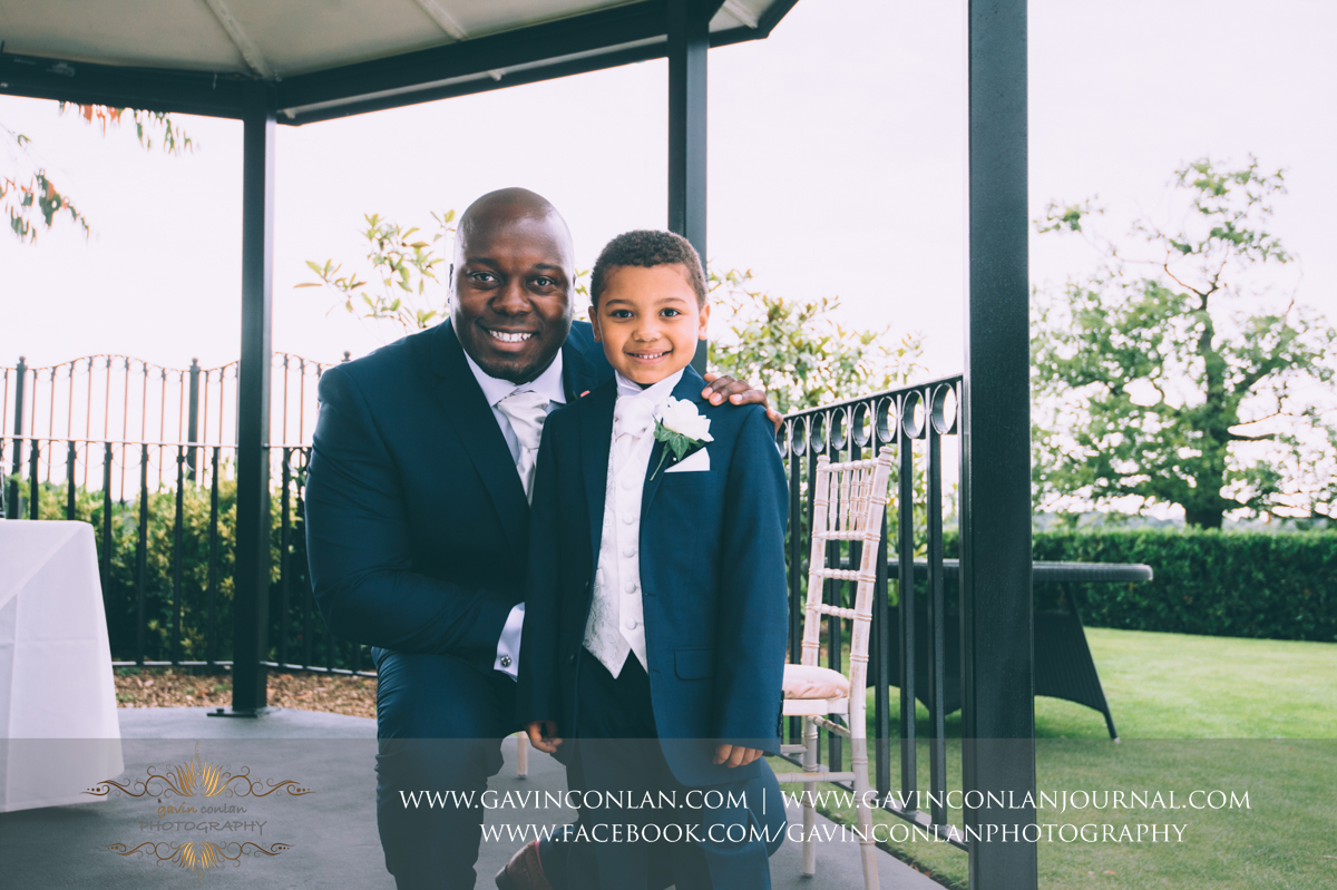 beautiful portrait of the groom and his son on The Lawn before the wedding ceremony at Stock Brook Country Club. Wedding photography at  Stock Brook Country Club  by  gavin conlan photography Ltd
