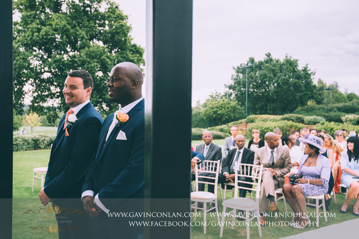 a portrait of the groom and his best man smiling whilst waiting on The Lawn as they wait for the bride to arrive and the wedding ceremony to begin at Stock Brook Country Club. Wedding photography at  Stock Brook Country Club  by  gavin conlan photography Ltd