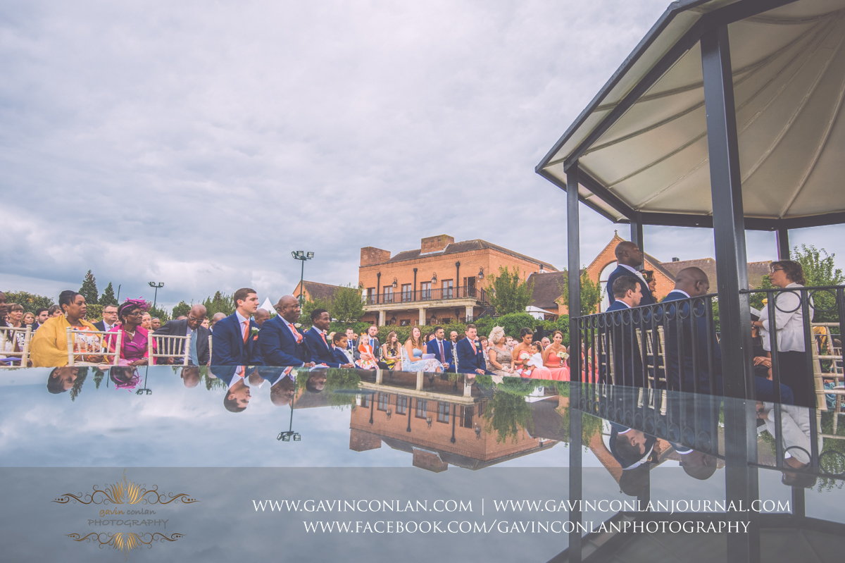 creative ceremony portrait of the bride and groom and their guests on The Lawn at Stock Brook Country Club. Wedding photography at  Stock Brook Country Club  by  gavin conlan photography Ltd