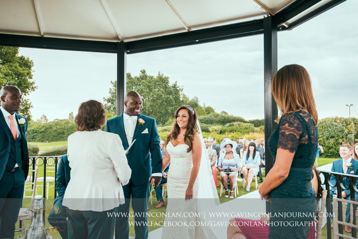 creative ceremony portrait full of emotion of the bride and groom holding hands on The Lawn at Stock Brook Country Club. Wedding photography at  Stock Brook Country Club  by  gavin conlan photography Ltd