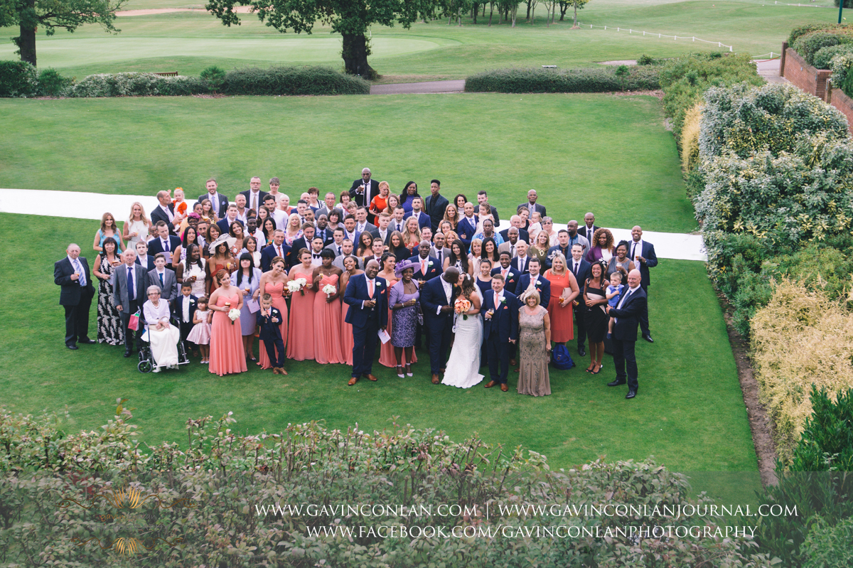 beautiful portrait of the bride and groom with all their wedding guests on The Lawn at Stock Brook Country Club. Wedding photography at  Stock Brook Country Club  by  gavin conlan photography Ltd