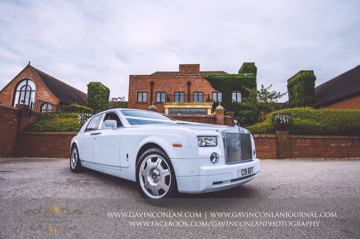 creative detail photograph of the Rolls Royce wedding car outside the main entrance of Stock Brook Country Club. Wedding photography at  Stock Brook Country Club  by  gavin conlan photography Ltd