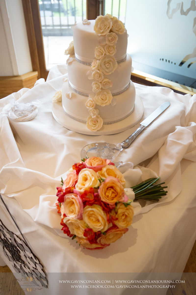 portrait of their wedding cake on display in The Banqueting Suite at Stock Brook Country Club. Wedding photography at  Stock Brook Country Club  by  gavin conlan photography Ltd