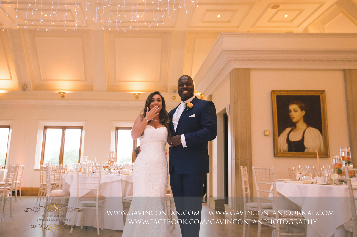 beautiful portrait of the bride and grooms emotional reaction of seeing their wedding breakfast set up for the first time in The Banqueting Suite at Stock Brook Country Club. Wedding photography at  Stock Brook Country Club  by  gavin conlan photography Ltd