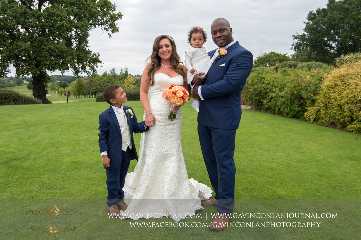 beautiful family portrait of the bride and groom with their son and daughter on The Lawn at Stock Brook Country Club. Wedding photography at  Stock Brook Country Club  by  gavin conlan photography Ltd
