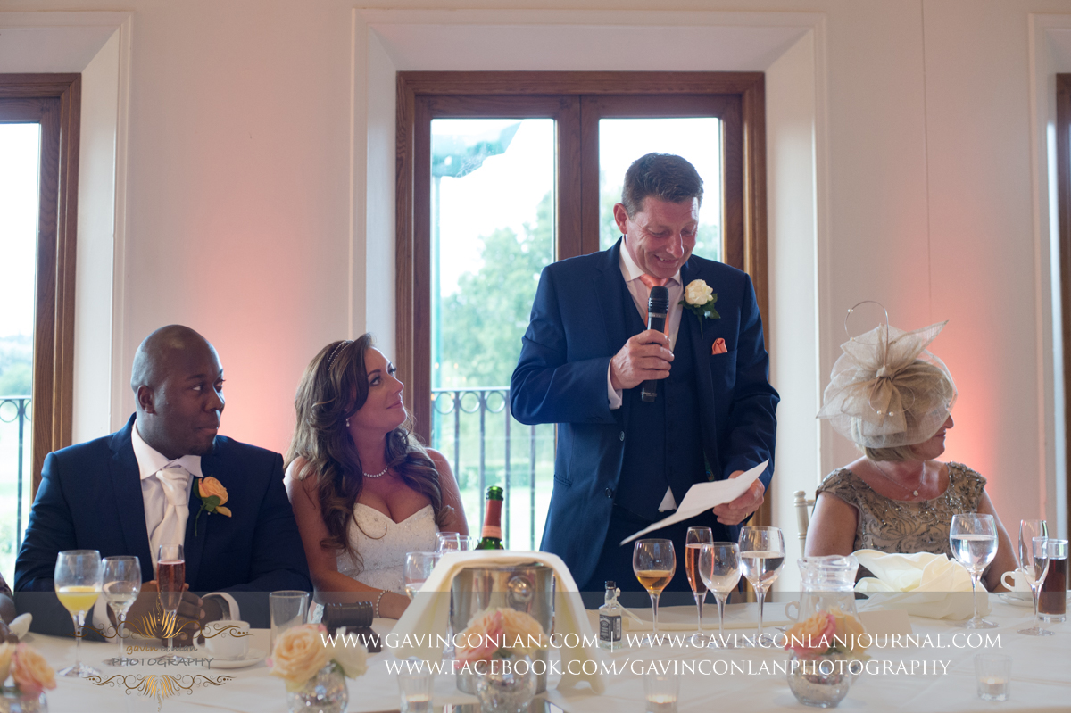 the father of the bride during his speech in The Banqueting Suite at Stock Brook Country Club. Wedding photography at  Stock Brook Country Club  by  gavin conlan photography Ltd