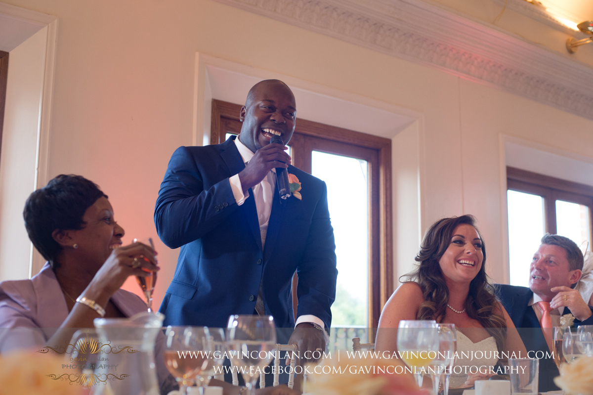 the groom during his speech in The Banqueting Suite at Stock Brook Country Club. Wedding photography at  Stock Brook Country Club  by  gavin conlan photography Ltd