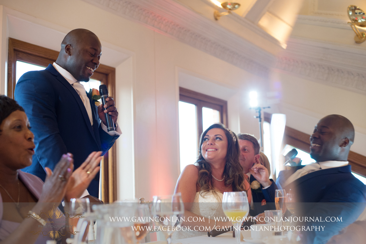 creative portrait of the groom during his speech in The Banqueting Suite at Stock Brook Country Club. Wedding photography at  Stock Brook Country Club  by  gavin conlan photography Ltd