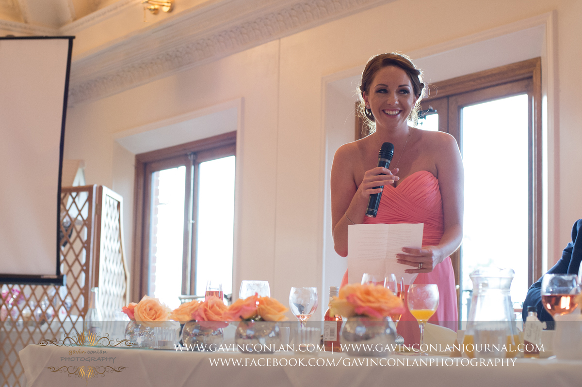 the bridesmaid during her speech in The Banqueting Suite at Stock Brook Country Club. Wedding photography at  Stock Brook Country Club  by  gavin conlan photography Ltd