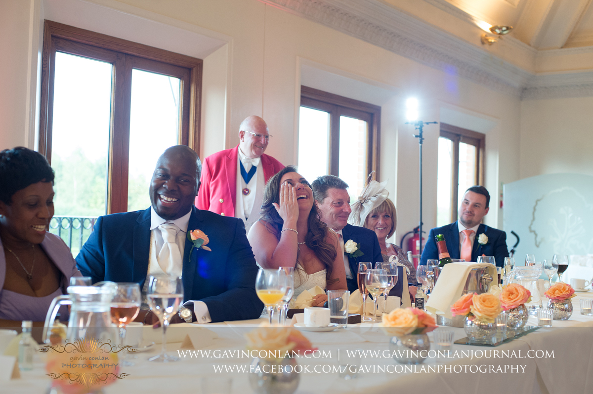 amazing expressions of the bride and groom during the wedding speeches in The Banqueting Suite at Stock Brook Country Club. Wedding photography at  Stock Brook Country Club  by  gavin conlan photography Ltd