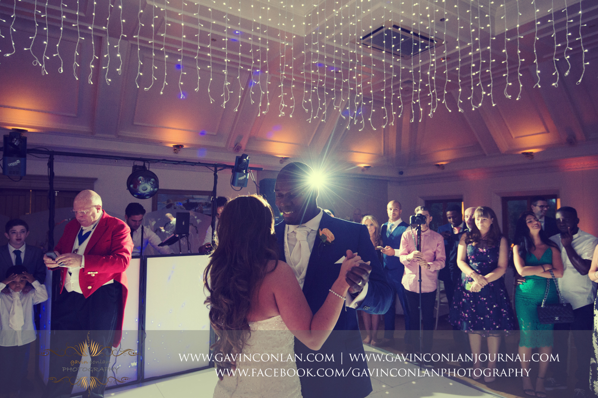 creative portrait of the bride and groom during their first dance in The Banqueting Suite at Stock Brook Country Club. Wedding photography at  Stock Brook Country Club  by  gavin conlan photography Ltd