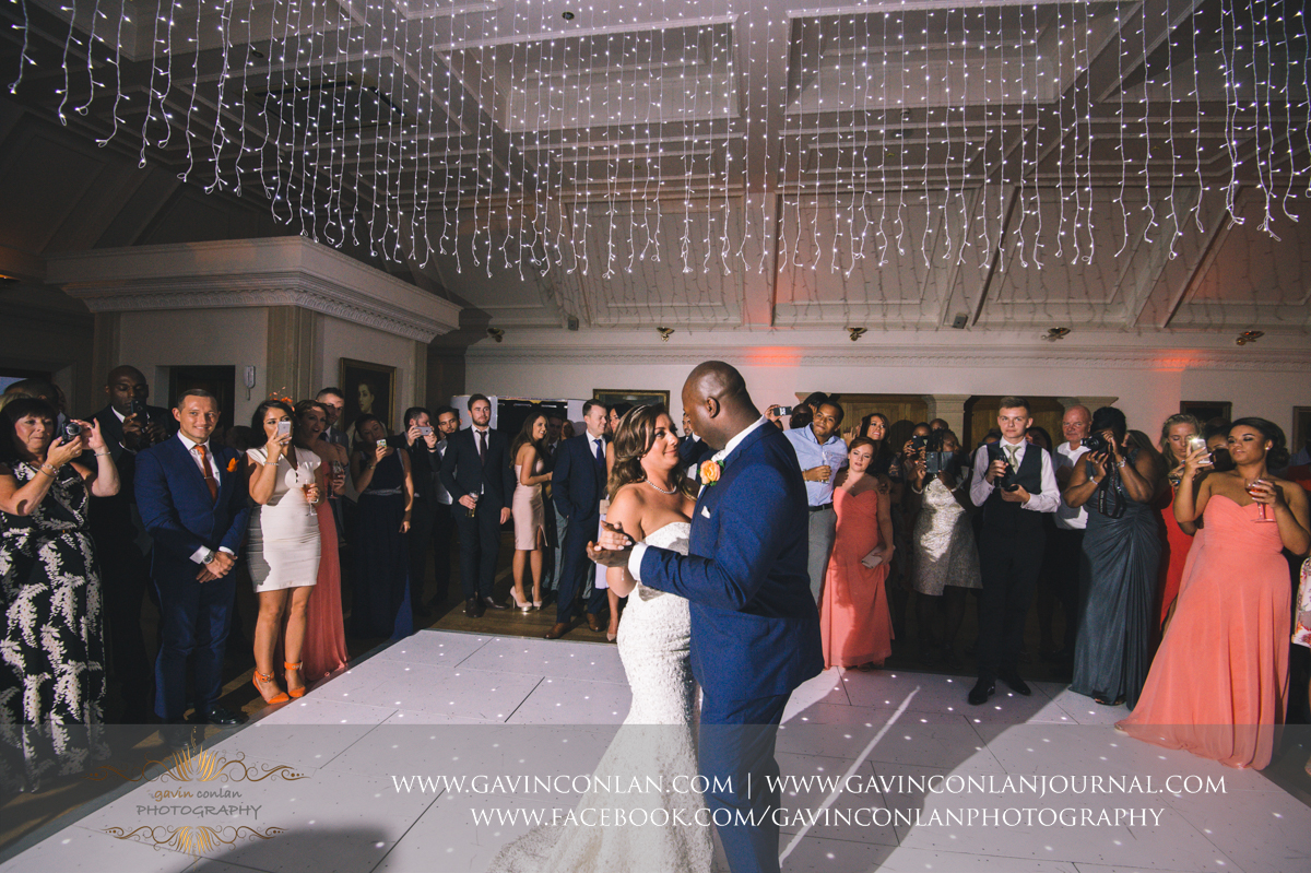wide angle portrait of the bride and groom during their first dance in The Banqueting Suite at Stock Brook Country Club. Wedding photography at  Stock Brook Country Club  by  gavin conlan photography Ltd