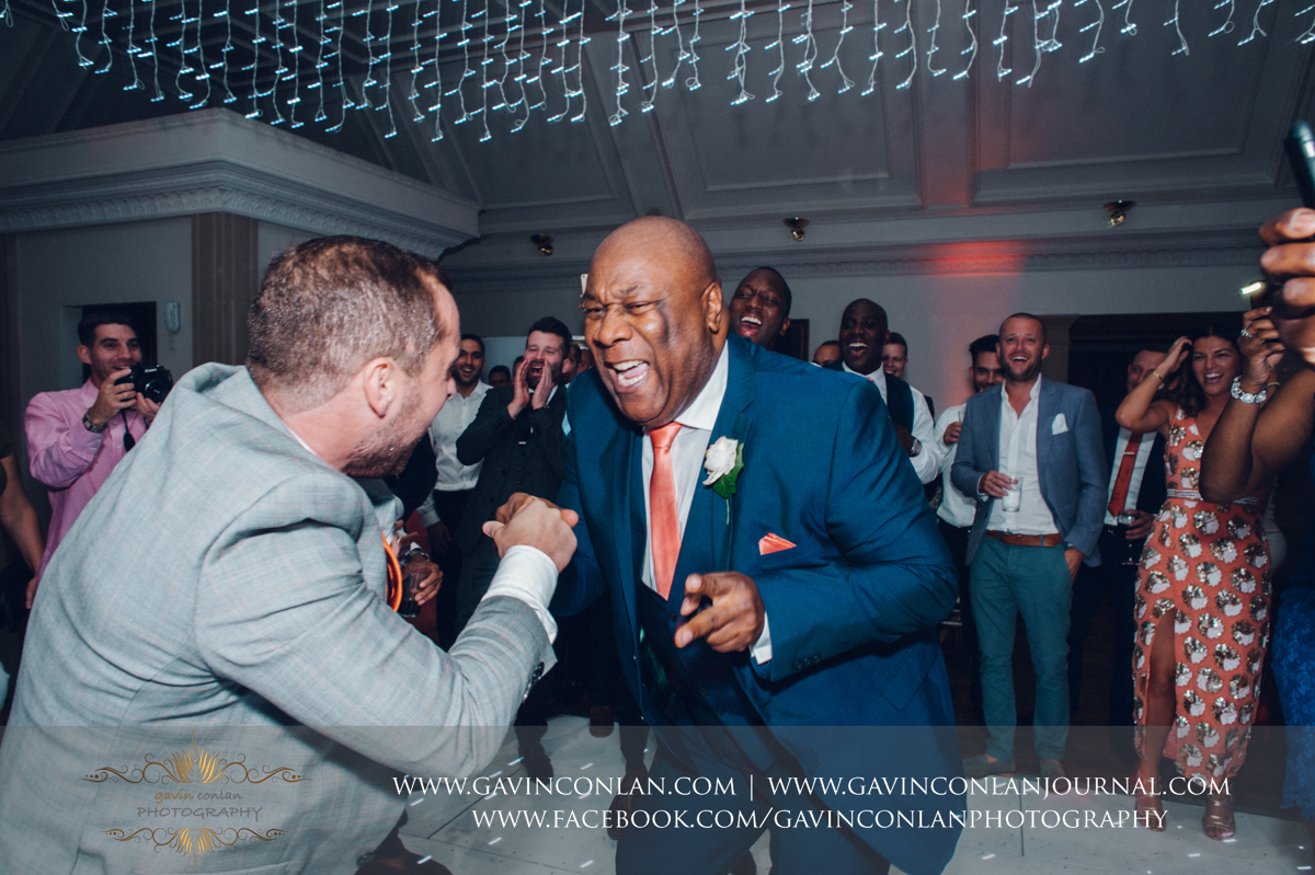 awesome dance floor action from the father of the bride in The Banqueting Suite at Stock Brook Country Club. Wedding photography at  Stock Brook Country Club  by  gavin conlan photography Ltd