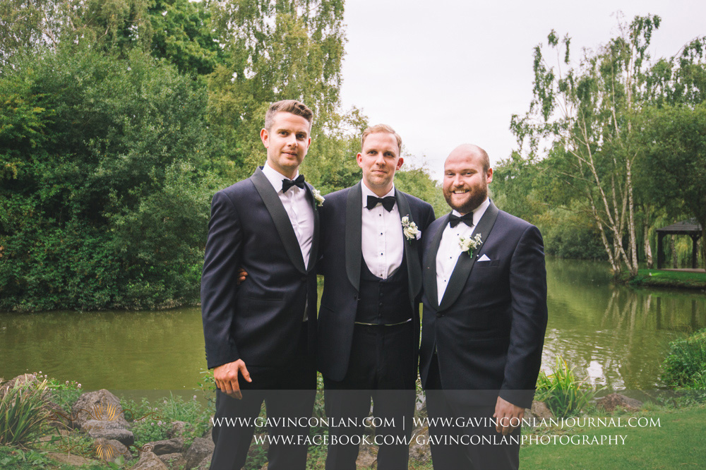 portrait of the groom and his best men at Great Hallingbury Manor. Essex wedding photography at  Great Hallingbury Manor  by  gavin conlan photography Ltd