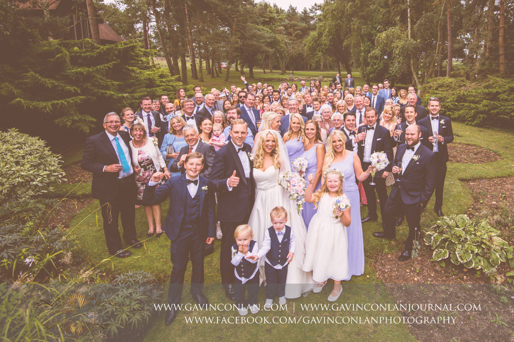 creative family and friends group portrait in the grounds of Great Hallingbury Manor. Essex wedding photography at  Great Hallingbury Manor  by  gavin conlan photography Ltd