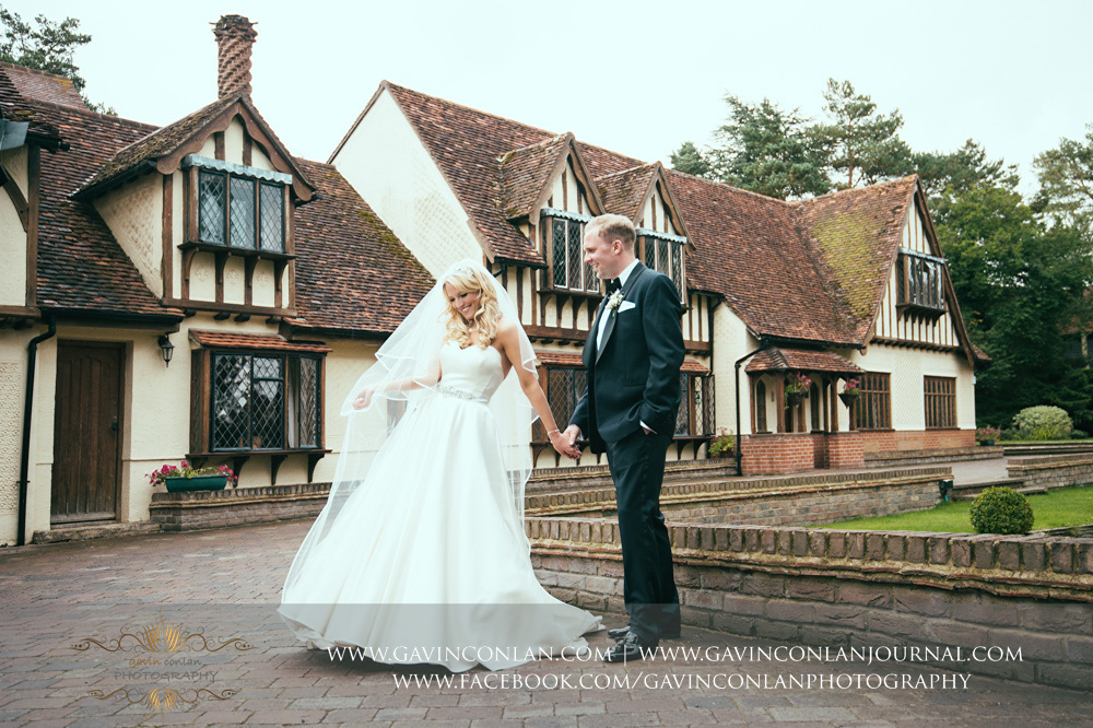 I'm absolutely obsessed by this couple portrait, the joy and emotion in the this photograph is beautiful. Portrait of the bride and groom outside Great Hallingbury Manor. Essex wedding photography at  Great Hallingbury Manor  by  gavin conlan photography Ltd