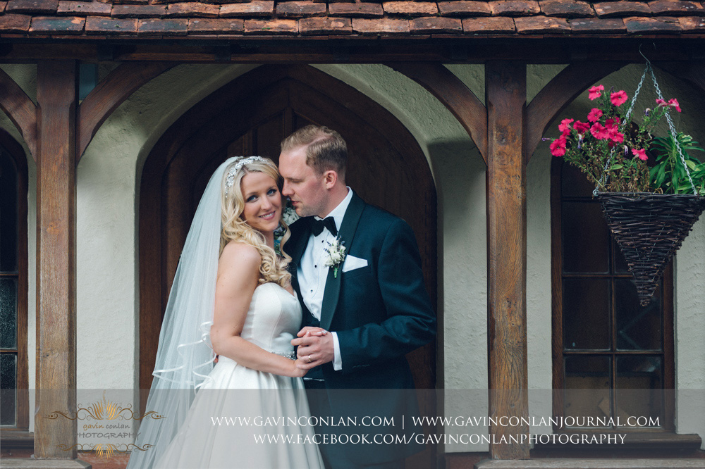 stunning portrait of the bride and groom outside of Great Hallingbury Manor. Essex wedding photography at  Great Hallingbury Manor  by  gavin conlan photography Ltd