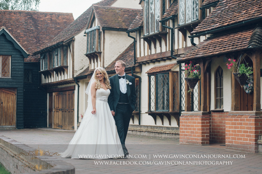 a portrait of the bride and groom looking beautiful outside of Great Hallingbury Manor. Essex wedding photography at  Great Hallingbury Manor  by  gavin conlan photography Ltd