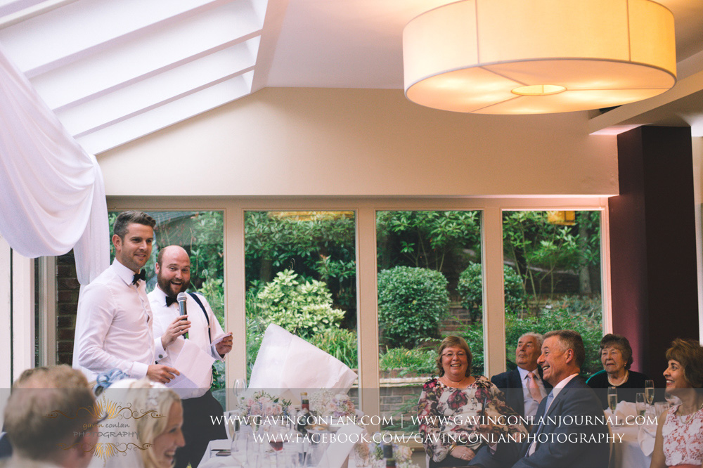 a portrait of the best men during their speech at Great Hallingbury Manor. Essex wedding photography at  Great Hallingbury Manor  by  gavin conlan photography Ltd