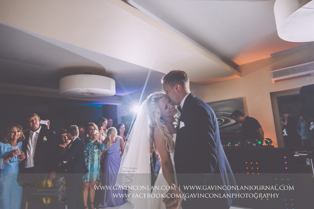 beautiful portrait of the bride and groom during their first dance at Great Hallingbury Manor. Essex wedding photography at  Great Hallingbury Manor  by  gavin conlan photography Ltd
