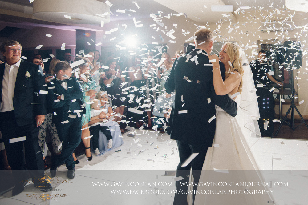 beautiful portrait of the bride and groom during their first dance as the wedding confetti cannon explodes at Great Hallingbury Manor. Essex wedding photography at  Great Hallingbury Manor  by  gavin conlan photography Ltd
