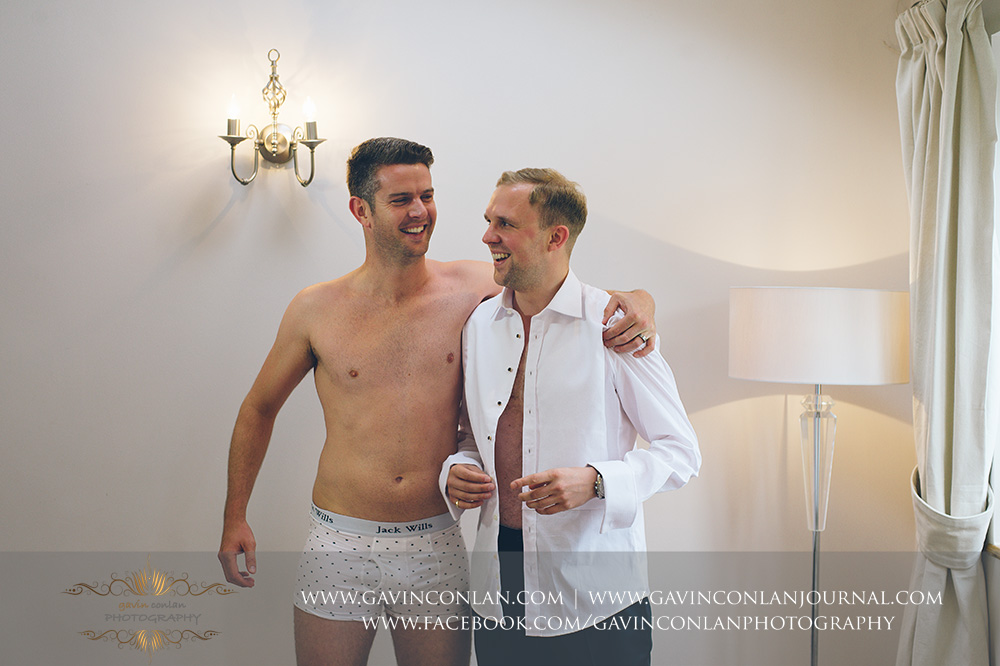 absolutely brilliant photo of the one of the best men photo bombing the grooms portraits in his pants.  Really funny moment during the groom preparations. Essex Wedding Photography by  gavin conlan photography Ltd